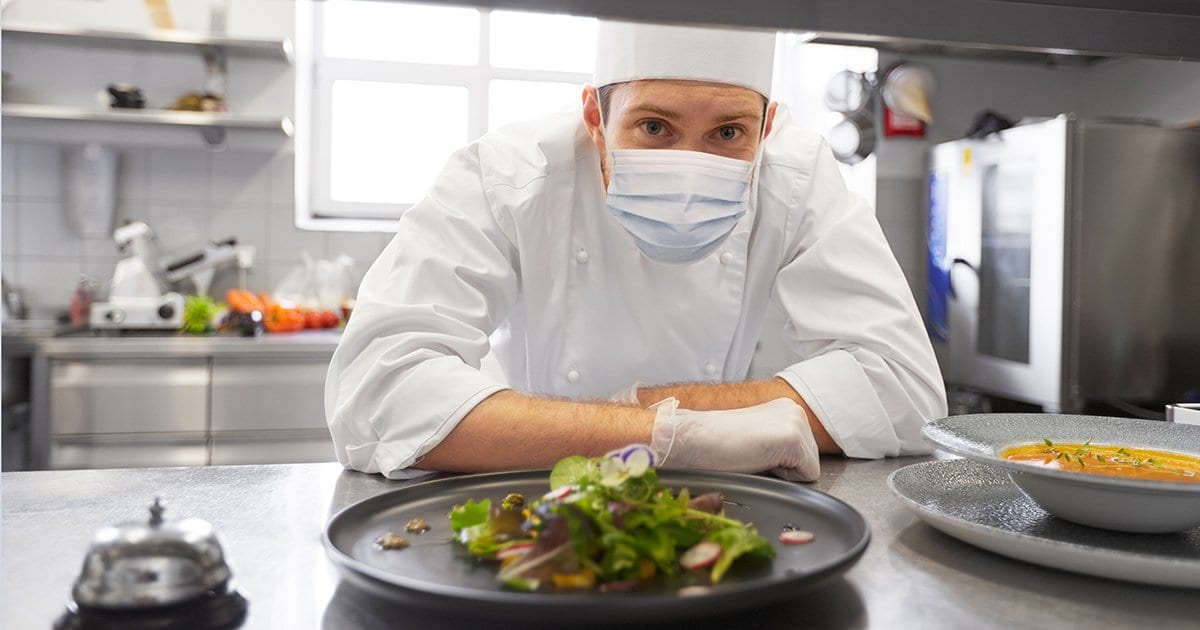Resuming business: health, safety and pandemic concept - male chef cook